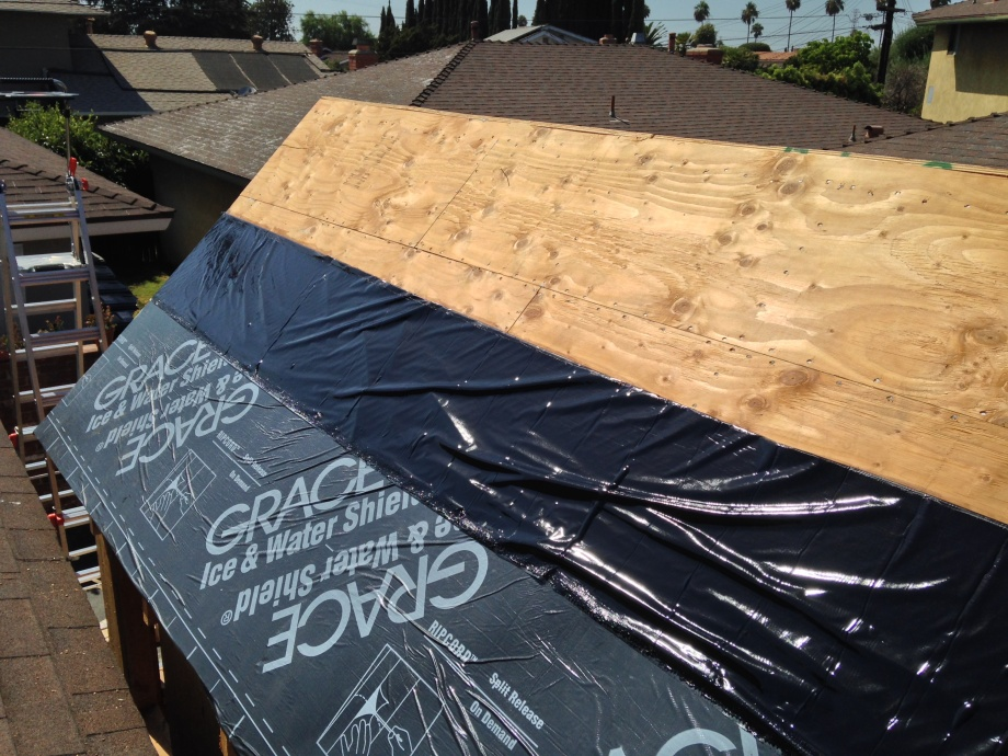 protecting the roof,  i learned putting grace ice and water shield on a very hot hot day makes it even more sticky. also learned putting it on by your self in long sections like this makes you hate how sticky it is. I had to get creative and use a long 2x4 that was 12 feet long and use it to help push the overlap up equally. I didn't get it the first time or second time or even the third time but the fourth time on the same piece and two hours later. Each time i did another piece it was easier and easier.